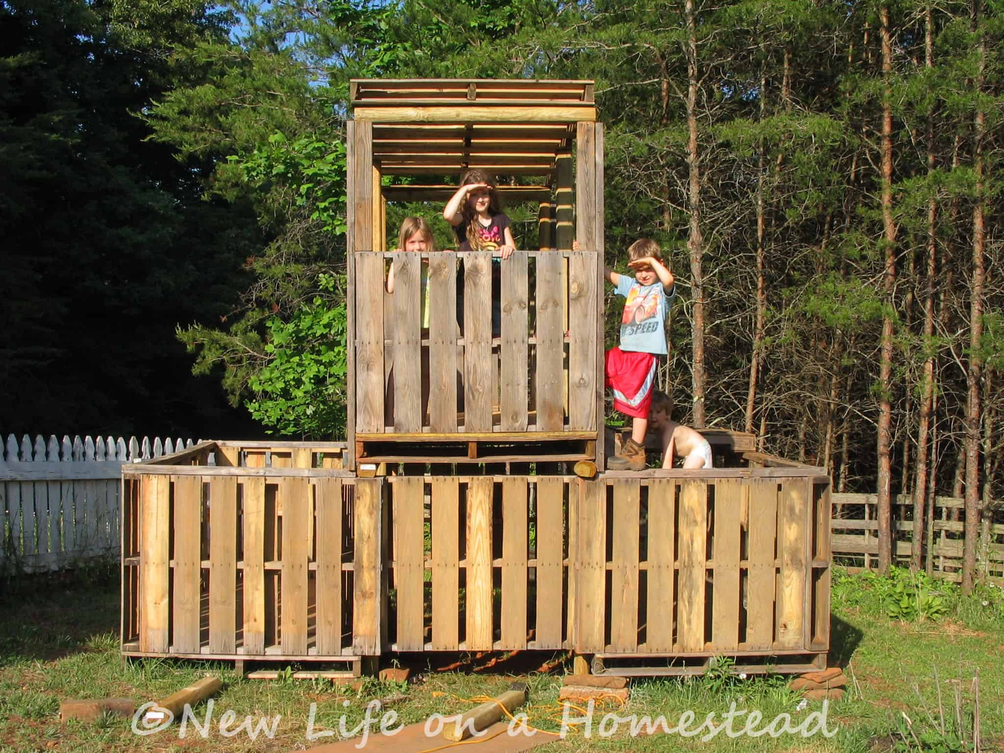 The pallet fort new life on a homestead homesteading blog for How to make a playhouse out of wood