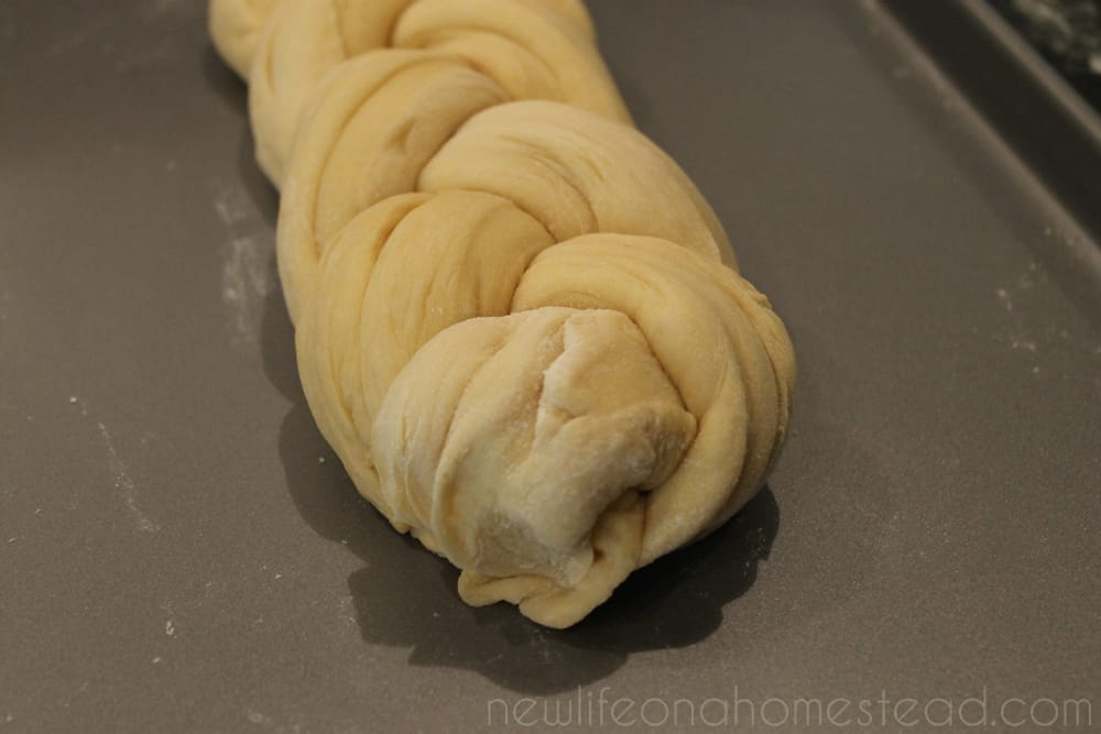 braided challah dough pinched end