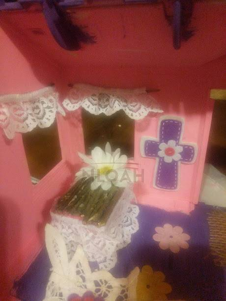 fairy bed inside dollhouse