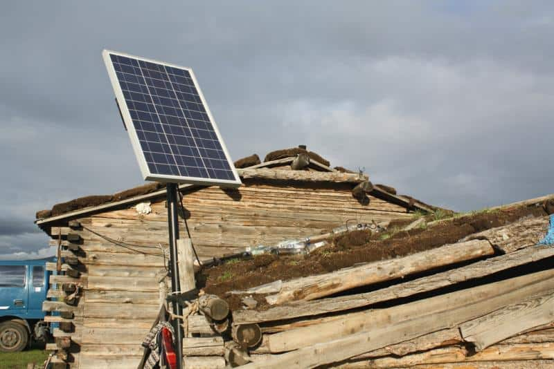 solar panel on old rustic cabin