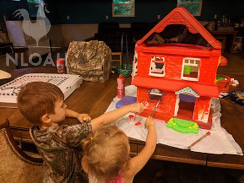 children painting dollhouse