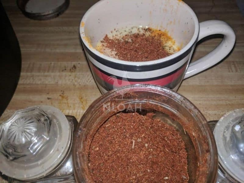 mixing spices in a cup