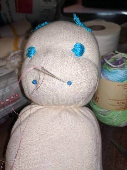 doll head with mouth corners