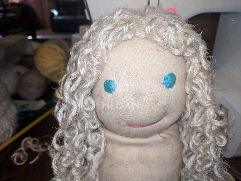 waldorf doll with eyes and wig