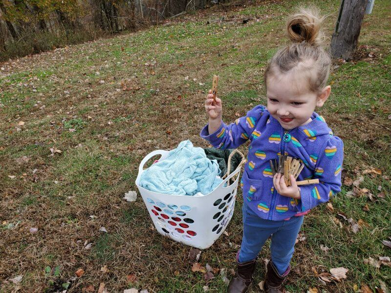 little girl helping with laundry