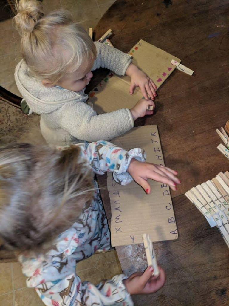 toddlers working with clip-it boards