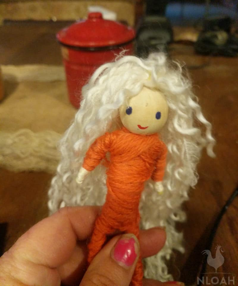 blonde felt doll red body