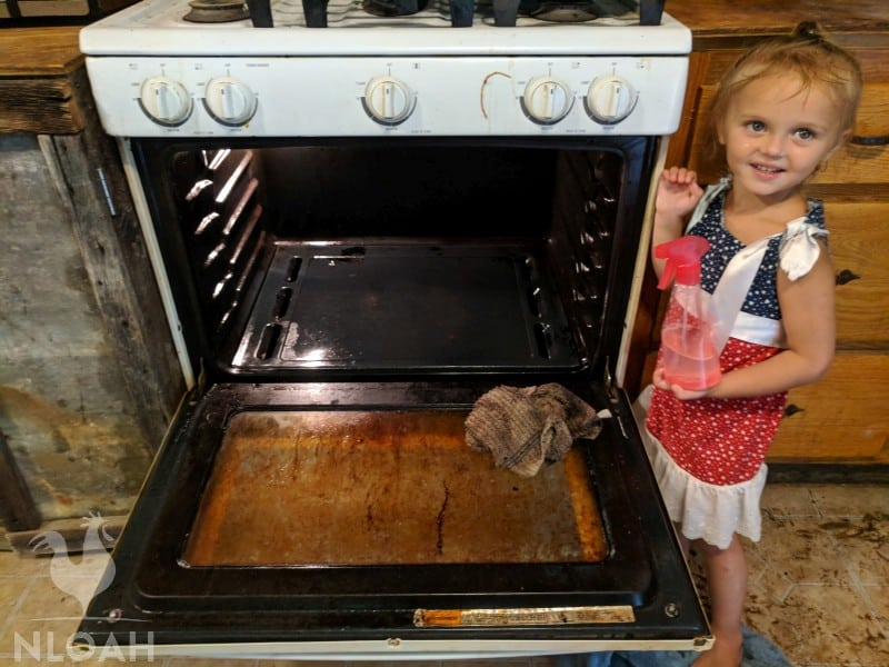little girl next to an oven