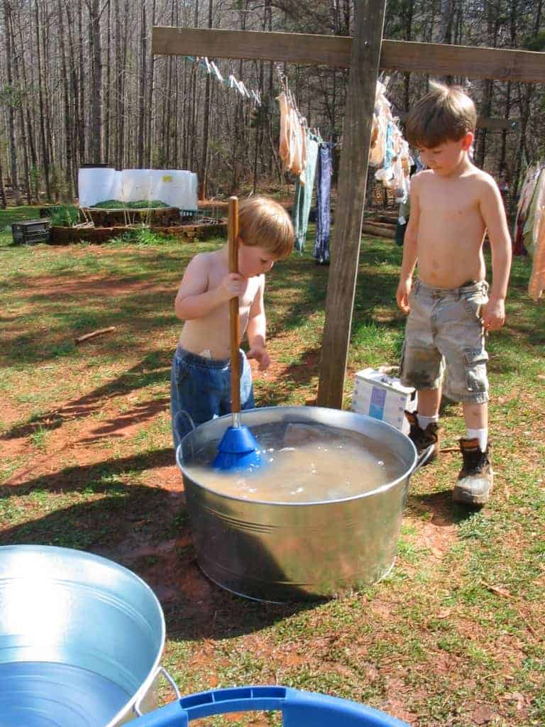 my two boys washing clothes by hand