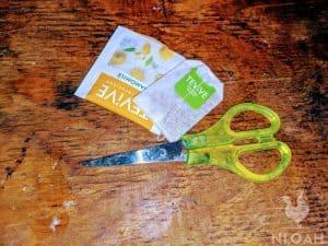 cutting tea bag using scissors