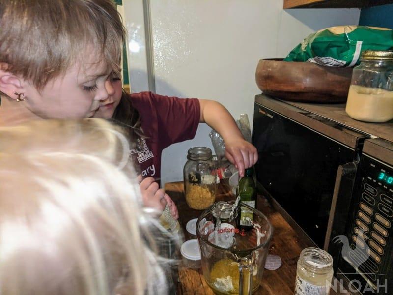 kids helping making lip gloss