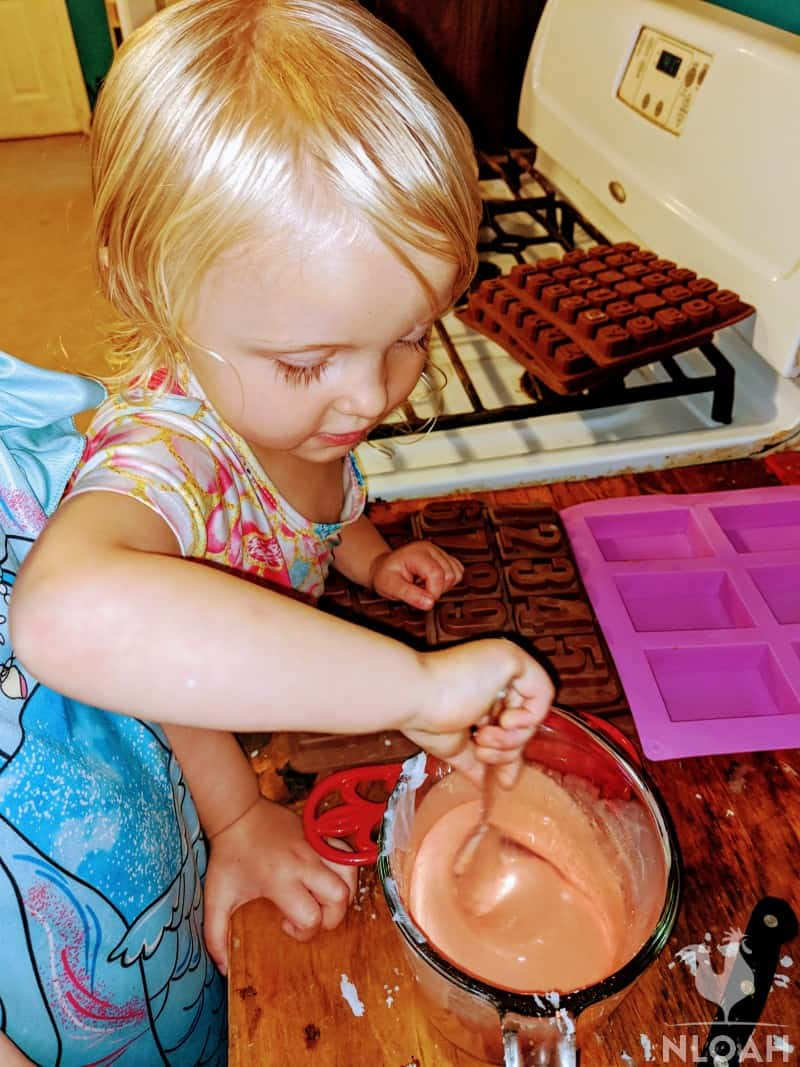little girl mixing soap ingredients
