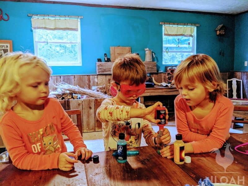 children doing experiments during homeschool