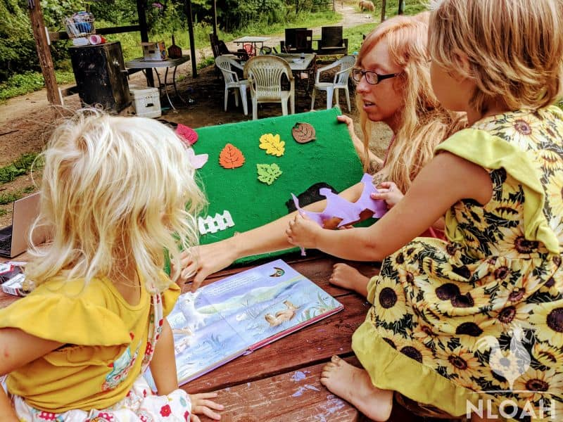 children using a felt board to learn
