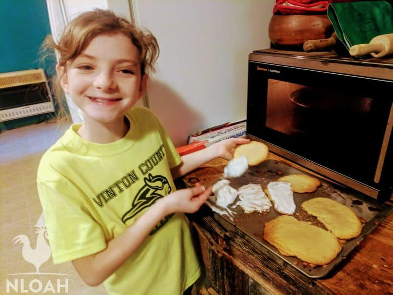 little girl baking cookies
