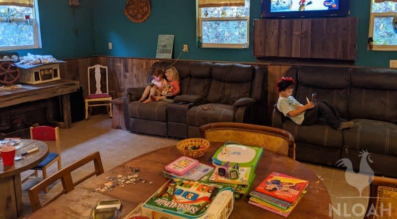 children reading on sofa