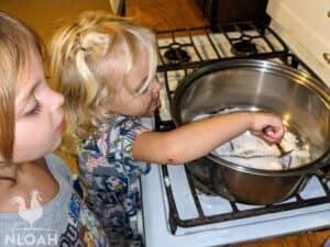 little girls stirring flour