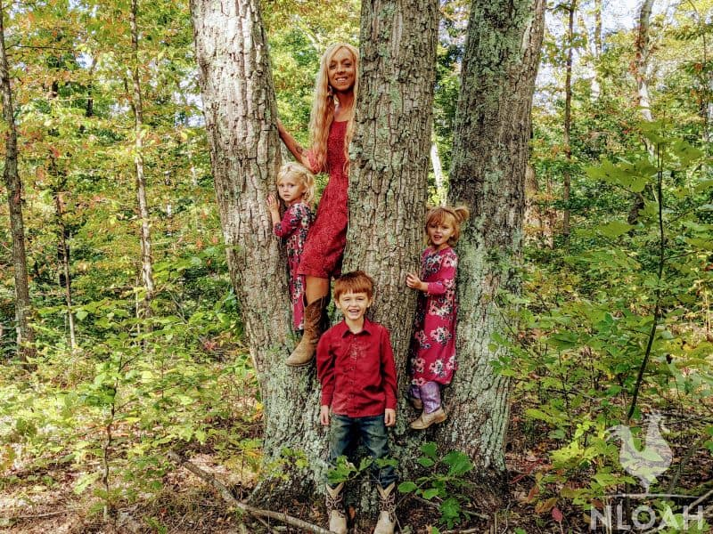 homeschooling mother and her 3 kids in the woods