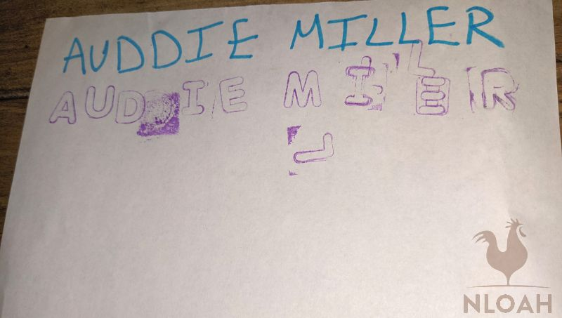 Auddie wrote her name using stamps