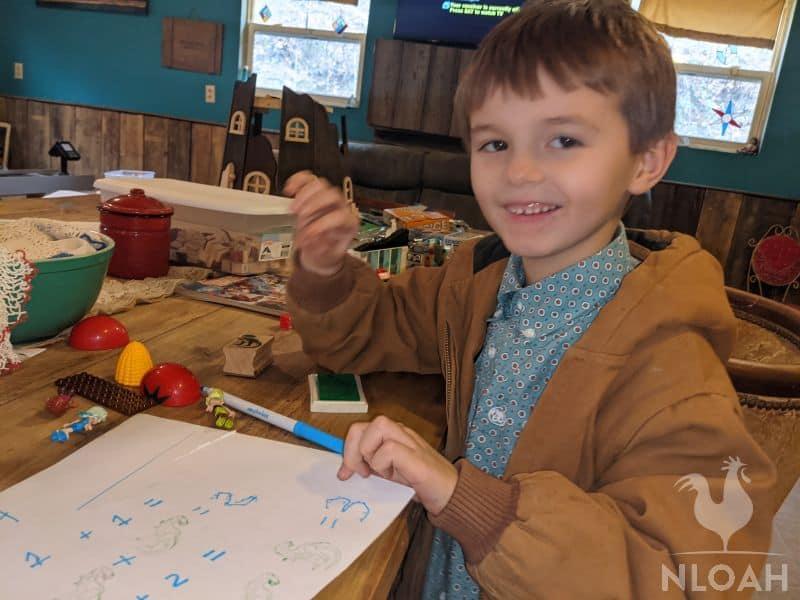 boy solving math problems