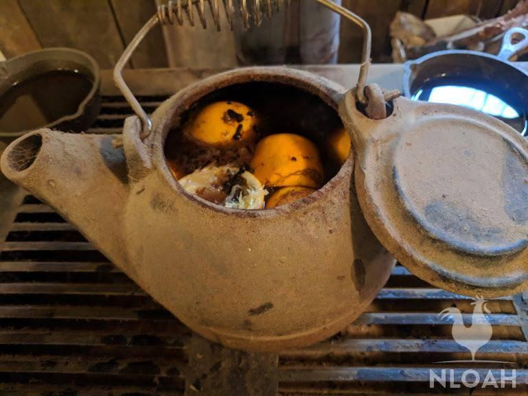 cast iron teapot filled with orange peels potpourri