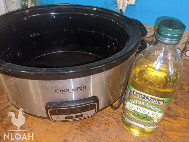 crockpot and bottle of olive oil