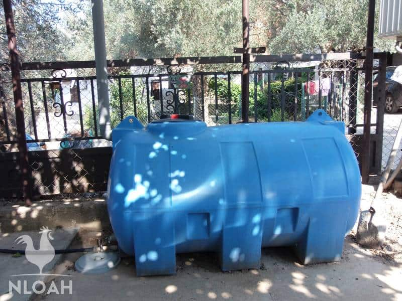 large drum for catcthing rainwater