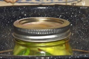 dimpled canned jar of hot peppers