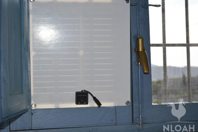 solar panel mounted on window